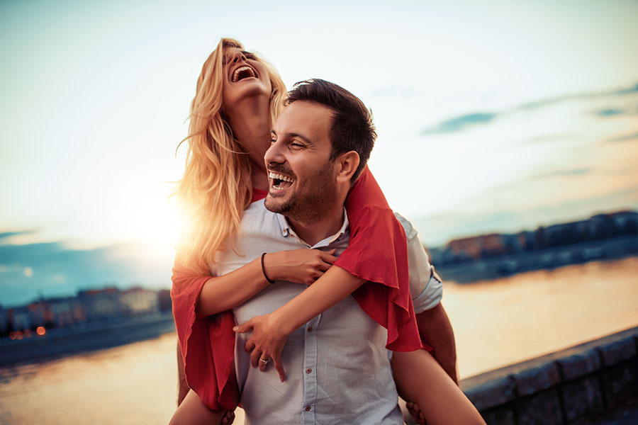 Woman Laughing on Mans Back