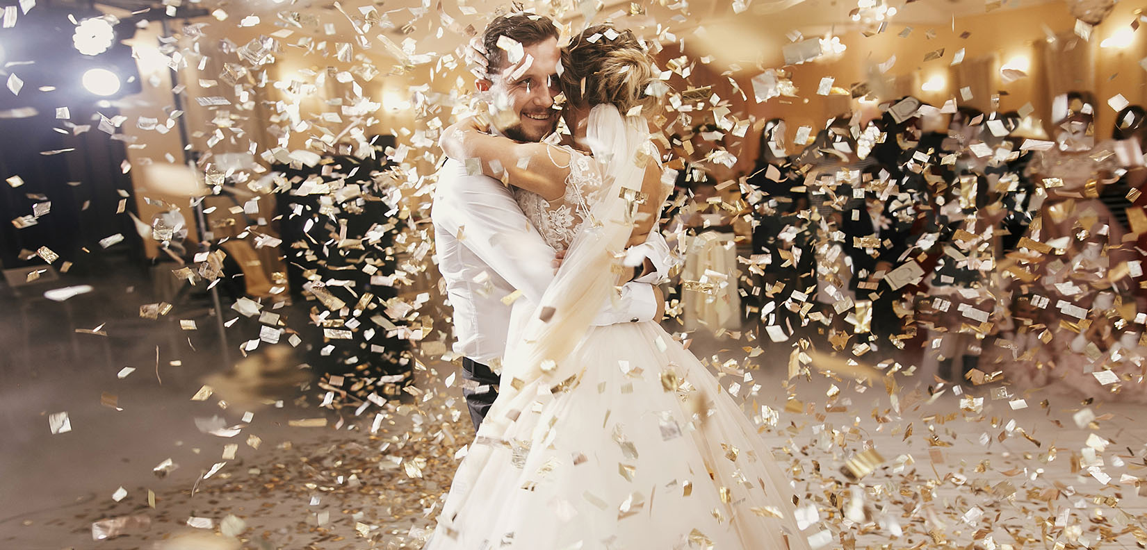 bride and groom dancing in confetti